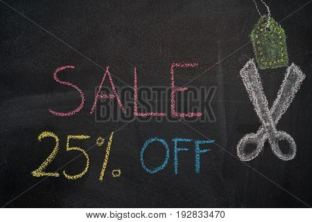 Sale 25% off. Sale and discount price sign with scissors cutting price tag drawn with chalk on blackboard