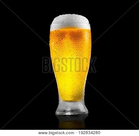 Beer. Cold Craft light and dark Beer in a glass with water drops.  Craft Beer close up isolated on black background