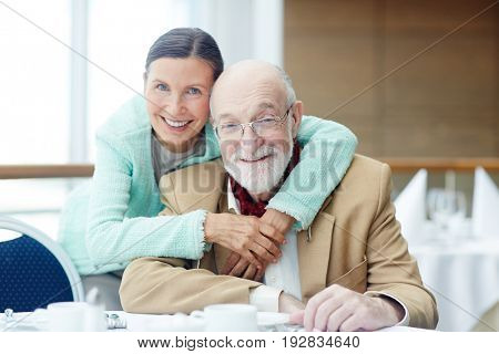 Smiling seniors spending time in cafe or restaurant