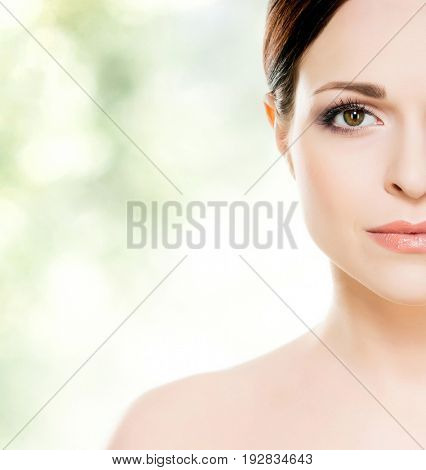 Portrait of a young, healthy and beautiful girl.  Healthcare, makeup, spa, face lifting and complexion concept. Close-up of a human face.