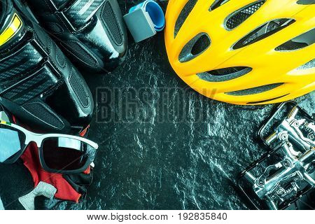 Bike and cycling sport accessories border and frame copy space black stone background