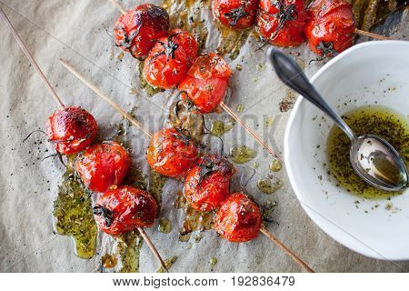 Grilled tomato skewers and toasted baguette