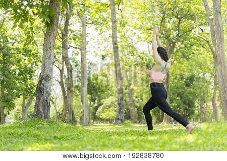 beautiful woman relax yoga in the park