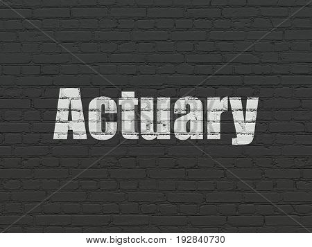 Insurance concept: Painted white text Actuary on Black Brick wall background
