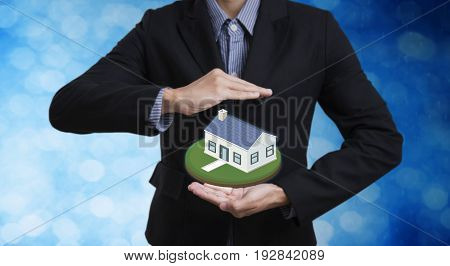 business salesman hand protection home concept home insurance and mortgage.