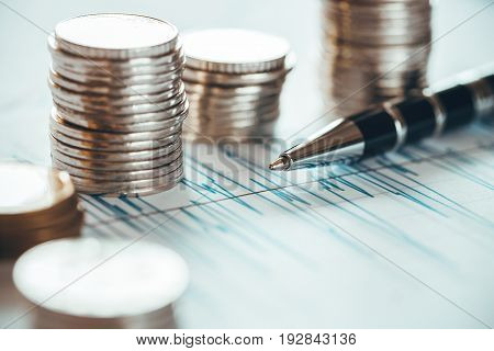 Financial business concept combination with coins and ballpoint pen