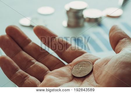 A US coin on a palm of hand