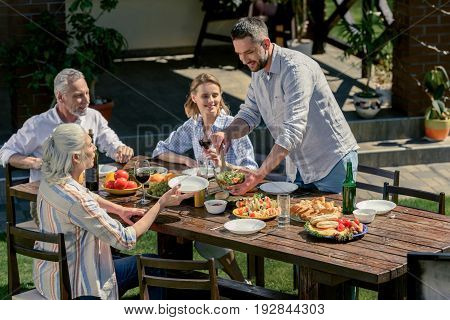 Happy Family Spending Time Together On Picnic Outdoors
