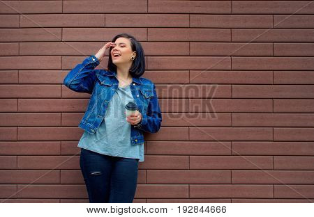 Pretty Brunnete Girl  Holding In Hand Hot Coffee