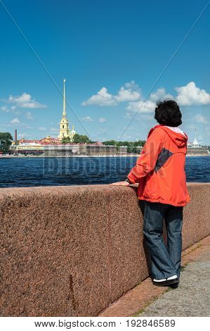 Tourist admiring a view of the Peter and Paul Cathedral St. Petersburg Russia