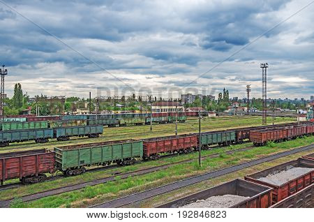 Railway sorting station in the background of a cloudy sky in front of a thunderstorm