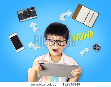 Nerdy kid is excited by tablet abilities and function