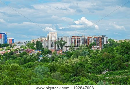 View of urban outskirts located on a hill in the background of a cloudy sky