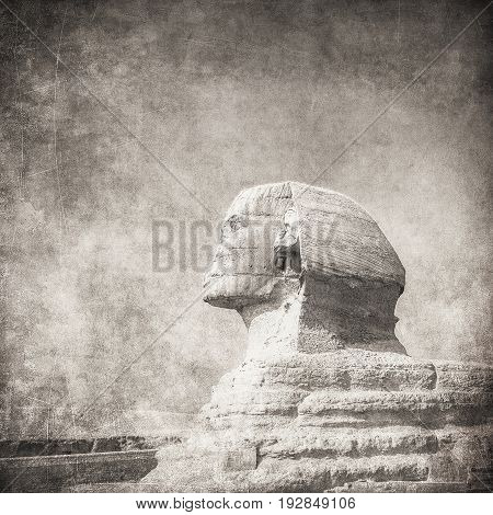 grunge image of sphynx and pyramid in Giza