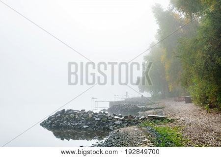 The figures of the fishermen in the fog