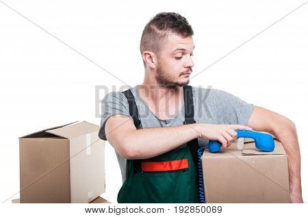 Mover Man Holding Cardboard Box Putting Dow Telephone Receiver
