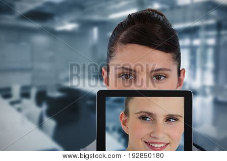 Portrait of female doctor with digital tablet against classroom