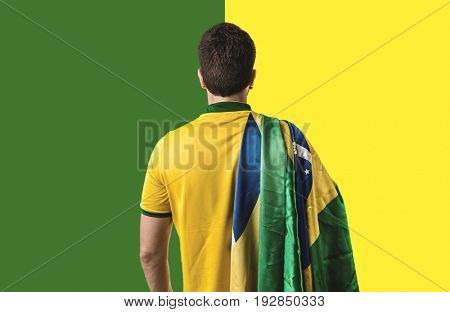 Brazilian holding the flag of Brazil
