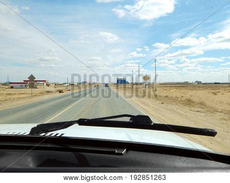 View from car window. Kazakhstan. Borankul village.