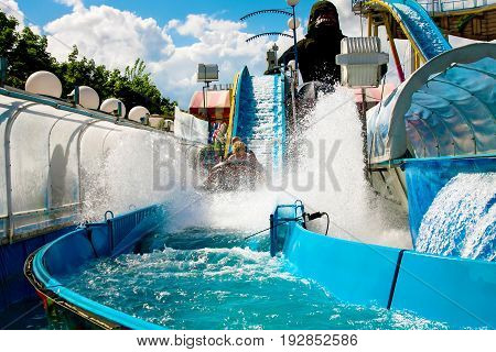 France Paris. August 3 2012. Amusement Park in the Tuileries gardens. Visitors enjoy rides in the Tuileries garden. Editorial