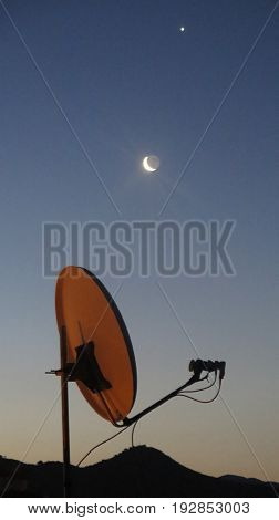 Moon venus and satelite dish one early morning