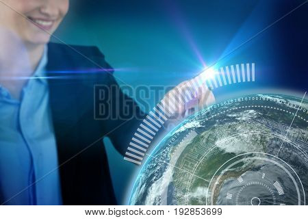 Businesswoman using invisible digital screen against blue background with vignette