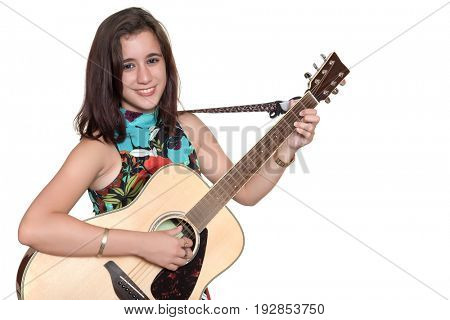 Beautiful teenage girl playing an acoustic guitar - Isolated on a white background