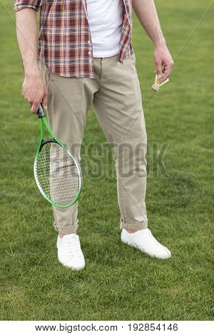 Cropped Shot Of Man Holding Badminton Racquet And Shuttlecock And Ready To Play