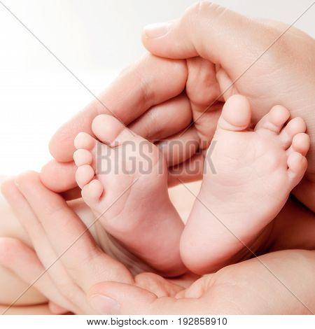 Leg handheld older child on a background.