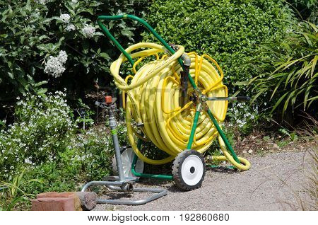 Hyde Hall Essex -17 June 2017: Hose on reel used for irrigation