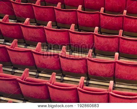 Rows of empty red seats in theater or cinema hall