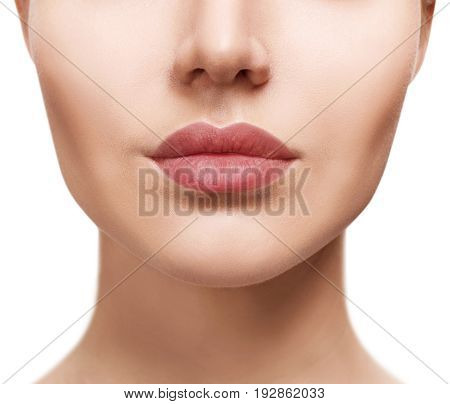 Perfect natural lips of young woman. Close- up beautiful female mouth. Plump full lips.