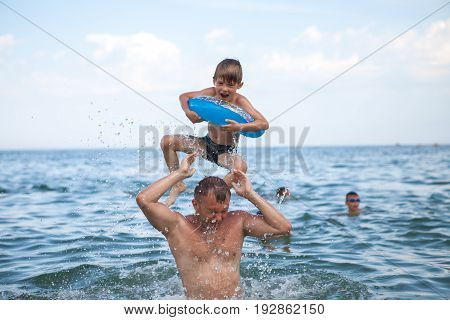 A Happy Family, Father And Son Bathe In The Water. Happy Family On Vacation, Vacation. Have Fun Play
