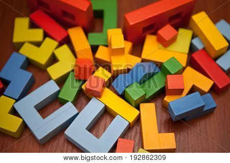 A Wooden Multicolored Designer Is Chaotically Scattered On The Table. Wooden Toy Blocks, Designer.