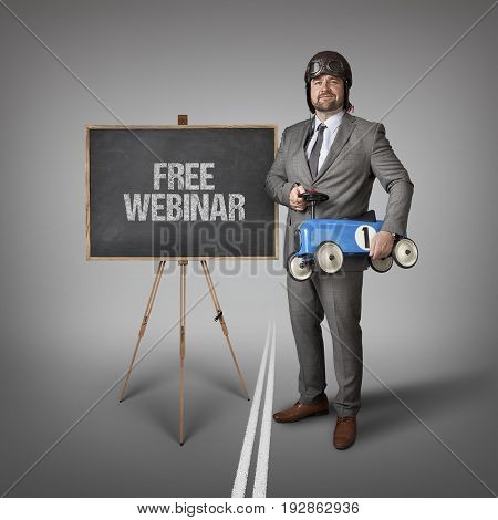 Free webinar text on blackboard with businessman and toy car