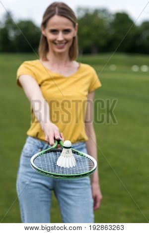 Woman Holding Badminton Racquet With Shuttlecock On The Top