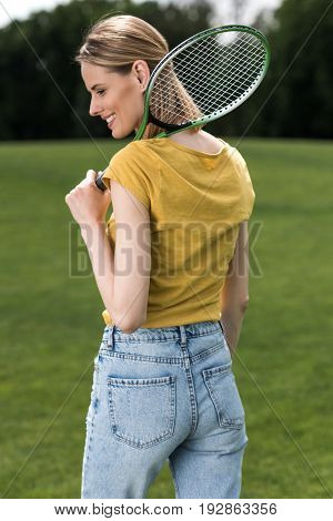 Attractive Woman Holding Badminton Racquet And Looking Away
