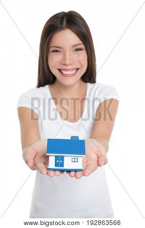 Homeowner buying first house happy Asian woman holding hands real estate house smiling showing miniature toy for home insurance protection concept.