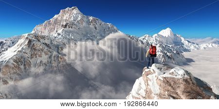 Young man up the mountain admiring the winter landscape. This is a 3d render illustration