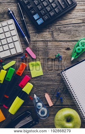 Top View of Business Concept. Office Accessories on wooden table. Above. Office supplies. Study Work Concept. Toning.
