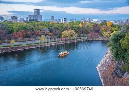 OsakaJapan - November 28 2015 : The Osaka Castle Park in autumn looking from Osaka castlea public urban park and historical site in Osaka Japan.