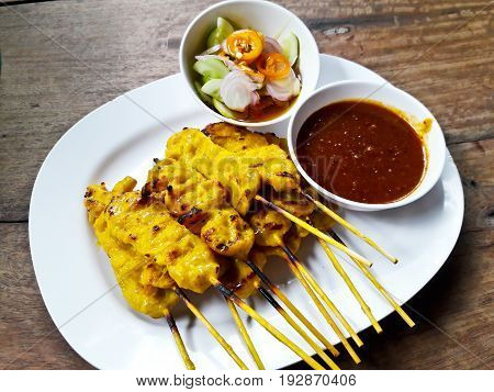 Grilled pork satay with peanut sauce and toast Thai food