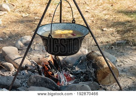 Cooking Soup In A Kettle On An Open Fire