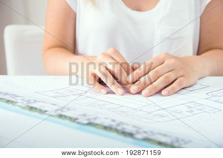 Young female architect and her new project