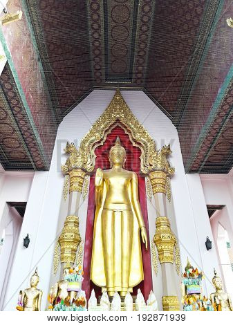 Golden buddha stands at Nakhon Pathom thailand