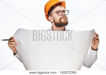 Engineer with beard on white isolated background, builder in helmet.