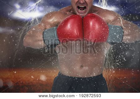 Aggressive boxer flexing muscles against splashing of powder
