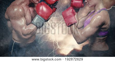 Side view of boxers with fighting stance against splashing of powder