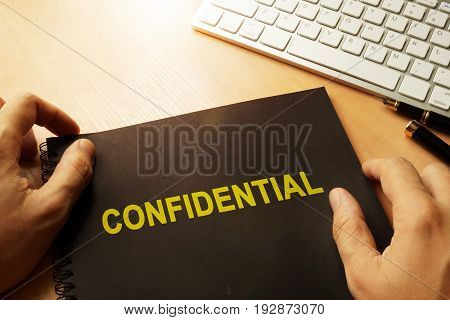 Document with label confidential on a table.