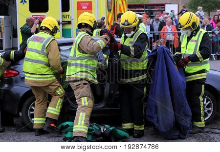 Beaulieu, Hampshire, Uk - May 29 2017: Firemen Removing A Passenger Door From A Car During A Vehicle